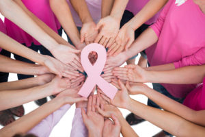 Hands-joined-in-circle-holding-breast-cancer-struggle-symbol--300x200 The Impact of Breast Reconstruction