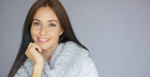 Elegant-middle-aged-woman-posing-with-woolen-warm-scarf-300x154 Minimal Incisions Can Make Big Differences