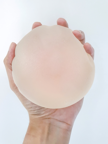 Hand Holding Breast Implant