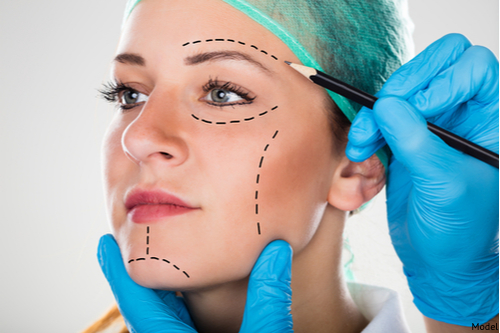A woman undergoing a facelift consultation.