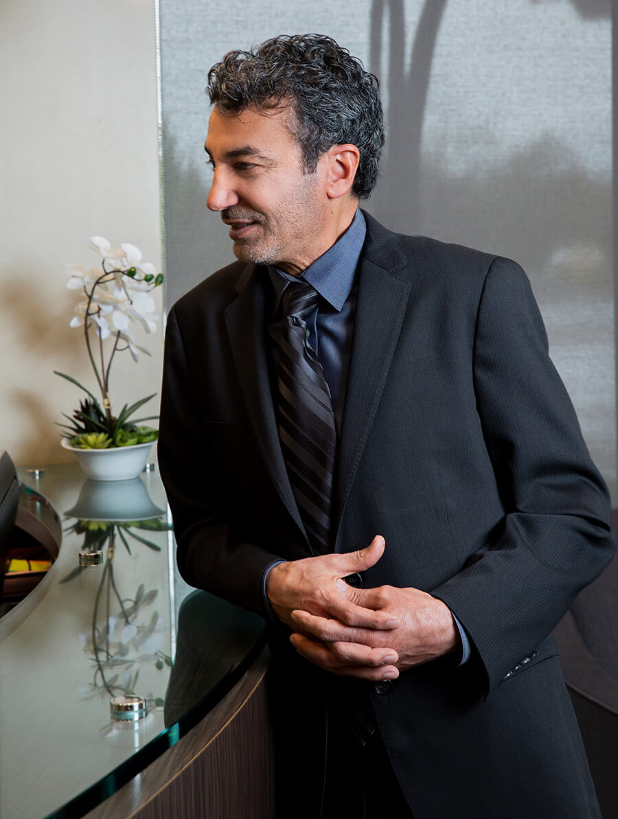 Dr. Mabourakh, talking with staff at Folsom Plastic Surgery