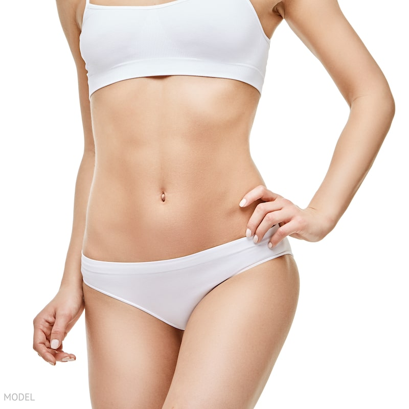 Close up image of a thin woman's abdomen. Body contouring concept.