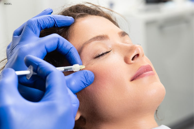Women getting BOTOX Cosmetic injected into her crow's feet